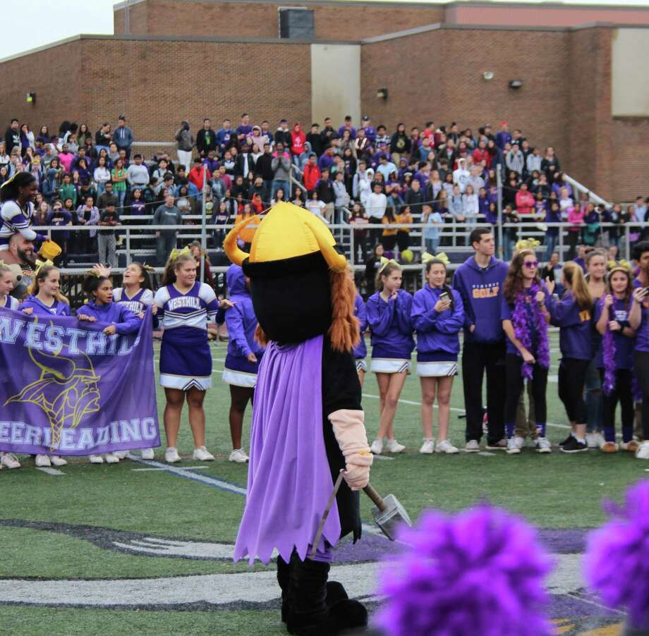 Westhill High School mascot — and custodian — Ruben Madiedo and the varsity athletes prepare for the powder scene at J. Walter Kennedy Stadium football field during the school's music video. Photo: Contributed Photo