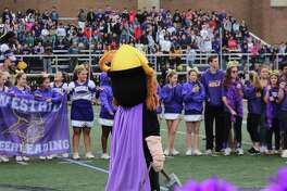 Westhill High School mascot — and custodian — Ruben Madiedo and the varsity athletes prepare for the powder scene at J. Walter Kennedy Stadium football field during the school's music video.