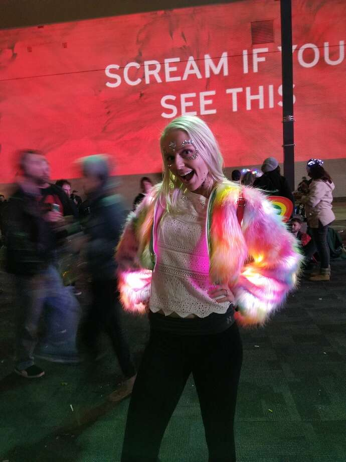 This is an appropriate level of excitement for a light-up fuzzy coat. Photo: Dana Burke/Houston Chronicle