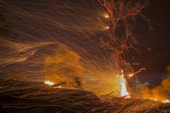 MONTECITO, CA - DECEMBER 16: A strong wind blows embers at the Thomas Fire on December 16, 2017 in Montecito, California. The National Weather Service has issued red flag warnings of dangerous fire weather in Southern California for the duration of the weekend. Prior to the weekend, Los Angeles and Ventura counties had 12 consecutive days of red flag fire warnings, the longest sustained period of fire weather warnings on record. The Thomas Fire is currently the fourth largest California fire since records began in 1932, growing to 400 square miles and destroying more than 1,000 structures since it began on December 4. (Photo by David McNew/Getty Images)