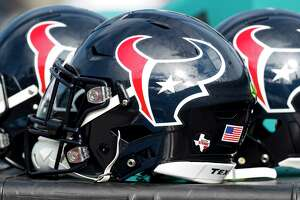 A trio of Houston Texans helmets sit on the sideoines before an NFL football game against the Jacksonville Jaguars at EverBank Field on Sunday, Dec. 17, 2017, in Jacksonville.