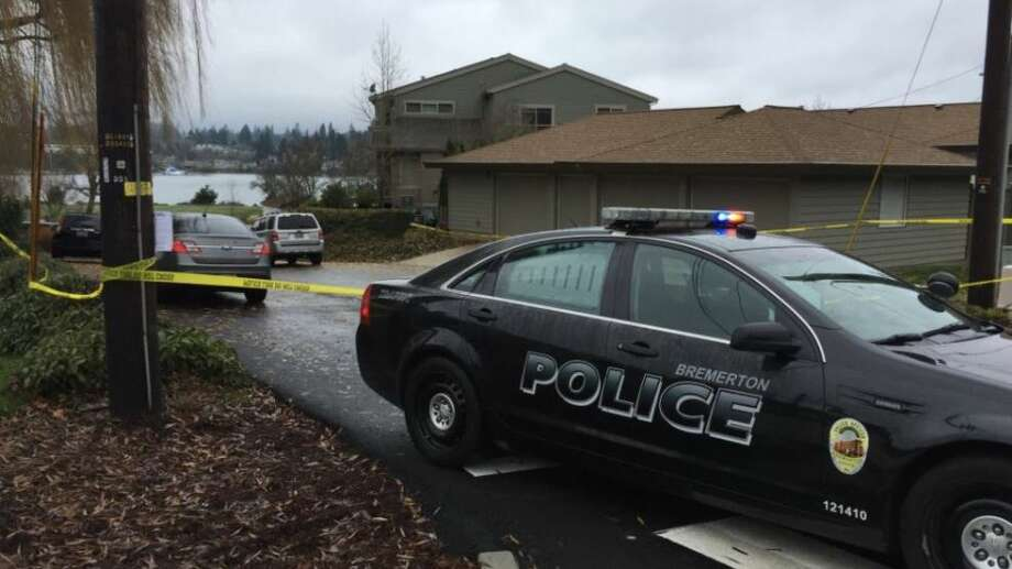 Police investigate a shooting that left two police officers wounded and a suspected gunman dead. Photo: KOMO News