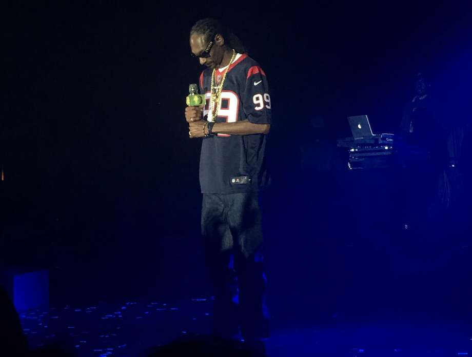 PHOTOS: More shots of Snoop Dogg at Tony Buzbee's private partySnoop Dogg performed at a private party while wearing a J.J. Watt Houston Texans jersey at the Hilton of Americas on Saturday, Dec. 16, 2017.Browse through the photos above for a look at Snoop Dogg performing at Tony Buzbee's private party. Photo: Mitchell Head