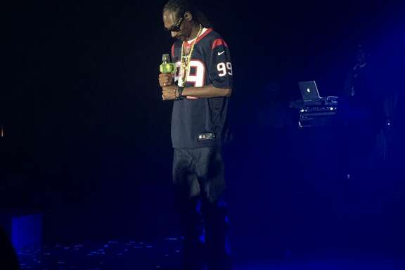 Snoop Dogg performed at a private party while wearing a J.J. Watt Houston Texans jersey at the Hilton of Americas on Saturday, Dec. 16, 2017.