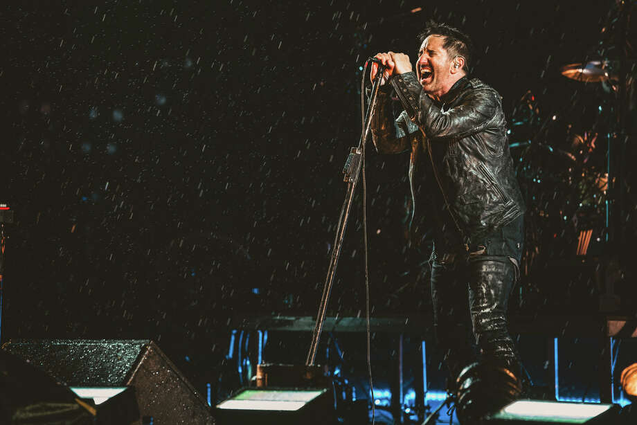 Trent Reznor and Nine Inch Nails play in the rain at Day for Night, 2018. Photo: Roger Ho