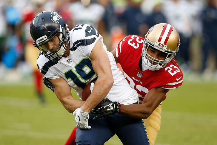 SANTA CLARA, CA - NOVEMBER 26: Tanner McEvoy #19 of the Seattle Seahawks is tackled by Ahkello Witherspoon #23 of the San Francisco 49ers at Levi's Stadium on November 26, 2017 in Santa Clara, California. (Photo by Lachlan Cunningham/Getty Images)