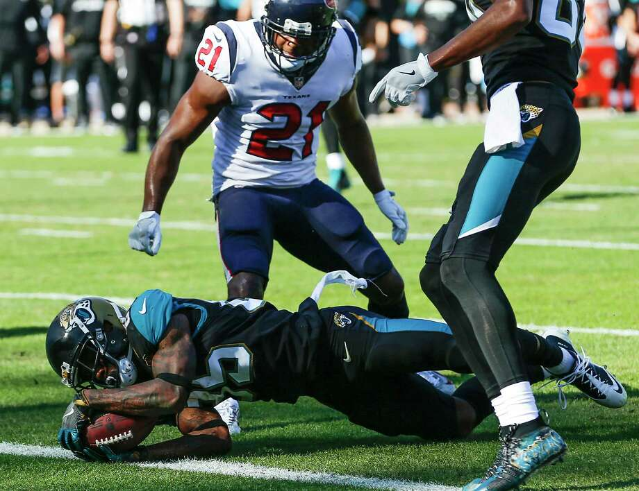 Jacksonville Jaguars wide receiver Jaydon Mickens (85) dives into the end zone past Houston Texans strong safety Marcus Gilchrist (21) for a 5-yard touchdown reception during the second quarter of an NFL football game at EverBank Field on Sunday, Dec. 17, 2017, in Jacksonville. Photo: Brett Coomer, Houston Chronicle / © 2017 Houston Chronicle