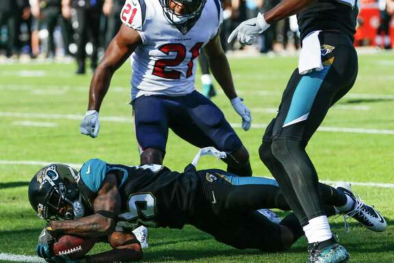 Jacksonville Jaguars wide receiver Jaydon Mickens (85) dives into the end zone past Houston Texans strong safety Marcus Gilchrist (21) for a 5-yard touchdown reception during the second quarter of an NFL football game at EverBank Field on Sunday, Dec. 17, 2017, in Jacksonville.