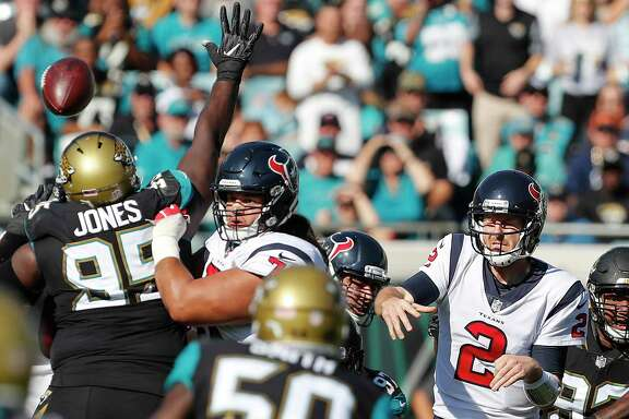 Houston Texans quarterback T.J. Yates (2) loses the handle on the football as he throws a pass against the Jacksonville Jaguars during the first quarter of an NFL football game at EverBank Field on Sunday, Dec. 17, 2017, in Jacksonville.