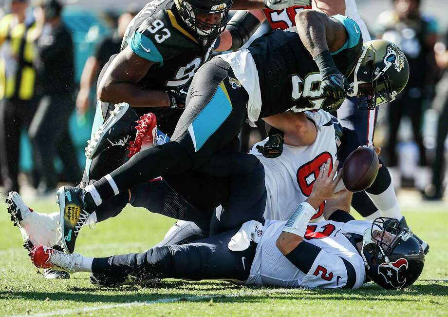Houston Texans quarterback T.J. Yates (2) is sacked by Jacksonville Jaguars defensive tackle Malik Jackson (97) during the first quarter of an NFL football game at EverBank Field on Sunday, Dec. 17, 2017, in Jacksonville. Photo: Brett Coomer, Houston Chronicle / © 2017 Houston Chronicle