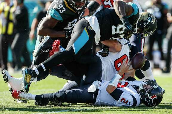 Houston Texans quarterback T.J. Yates (2) is sacked by Jacksonville Jaguars defensive tackle Malik Jackson (97) during the first quarter of an NFL football game at EverBank Field on Sunday, Dec. 17, 2017, in Jacksonville.