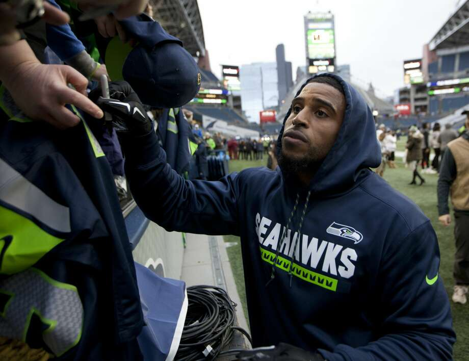 """WAGNER GETS RECORD-SETTING EXTENSION AFTER PRACTICE Seahawks star Bobby Wagner showed up for practice Friday wearing his helmet and uniform, suggesting he might play. But still without a new extension, the All-Pro middle linebacker elected to just cheer on and support his teammates, without participating in on-field work, as he'd been doing since May.  On Sunday, day three of camp, he'll be wearing his helmet and uniform and playing. That record-setting contract he'd been pursuing? It's been secured now. Wagner, serving as his own agent, inked pen to paper just after 6 p.m. Friday. The deal is for three years and $54 million with 40.2 fully guaranteed, according to Bleacher Report.  So now it's only logical to believe that Wagner's appearance signaled he was closer to a new deal with the Seahawks. Prior to wearing his uniform Friday, he was just in a hoodie and sweats on Thursday.  Quarterback Russell Wilson told reporters that he believed that the team will get a deal done with his fellow 2012 draftee, and that it'll re-set the linebacker market.  Both predictions came true.  """"Ain't nobody better than him,"""" Wilson said of Wagner. """"That's just the honest truth."""" Photo: John Froschauer/AP"""