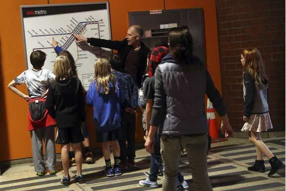 Retired SFMTA planner Peter Albert recaps the route at the end of a field trip to familiarize After School Enrichment Program 5th graders with the MUNI train system in San Francisco, Calif., on Wednesday, December 13, 2017.