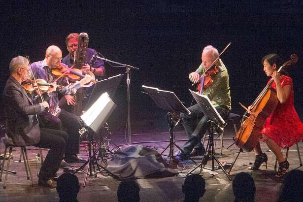 The musician Ralph Carney sits in with the Kronos Quartet