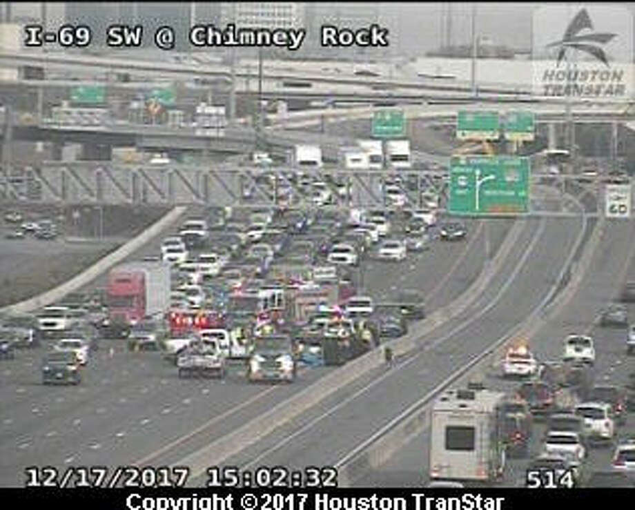 A three-car wreck shut down Sunday afternoon traffic on Southwest Freeway. Photo: Transtar