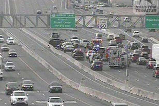 A three-car wreck shut down Sunday afternoon traffic on Southwest Freeway.