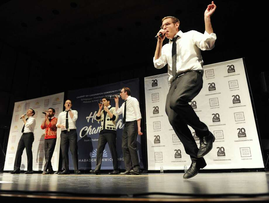 The Maccabeats perform at the Chanuka Concert presented by Chabad of Greenwich Community Center at Greenwich High School in Greenwich, Conn. Sunday, Dec. 17, 2017. The Jewish a cappella group The Maccabeats headlined the show with an entertaining array of holiday and pop music. Carmel Academy's Angels & Prophets also performed a set and Rabbi Yossi Deren lit the menorah with First Selectman Peter Tesei. Photo: Tyler Sizemore / Hearst Connecticut Media / Greenwich Time