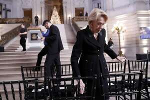 San Francisco Chief of Protocol Charlotte Mailliard Shultz makes seat assignments before a service Celebrating the Life of Mayor Edwin M. Lee at San Francisco City Hall in San Francisco, Calif., on Sunday, December 17, 2017.