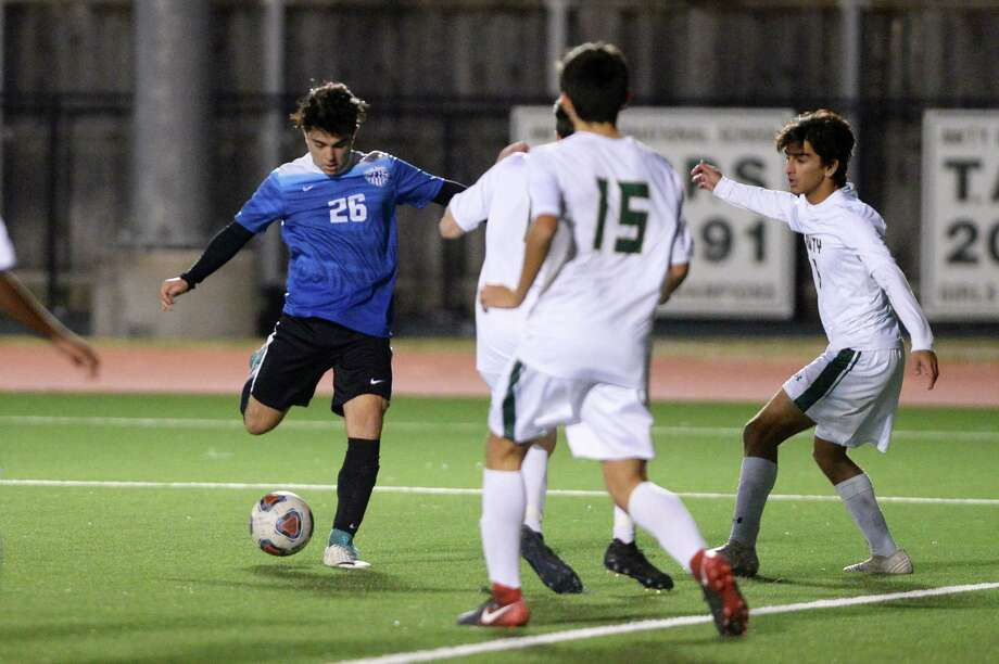 Pablo Vilas (26) of Episcopal scores a goal past multiple defenders during the second half of a varsity soccer match between the Awty International Rams and the Episcopal Knights on Friday, December 15, 2017 at Awty International School, Houston, TX. Photo: Craig Moseley, Staff / ©2017 Houston Chronicle