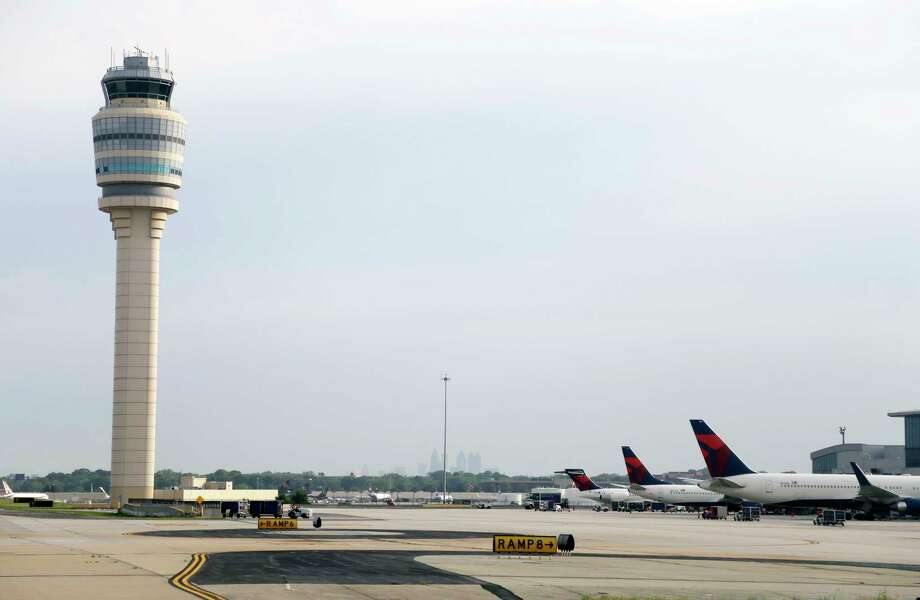 FILE- This May 9, 2016, file photo, shows an air traffic control tower at their gates at Hartsfield–Jackson Atlanta International Airport in Atlanta. Authorities say a power outage at the Hartsfield-Jackson Atlanta International Airport has disrupted ingoing and outgoing flights. Airport spokesman Reese McCraine says the outage occurred early Sunday, Dec. 17, 2017. He says all airport operations are being affected and that outgoing flights were halted. (AP Photo/Mike Stewart, File) Photo: Mike Stewart, STF / Copyright 2017 The Associated Press. All rights reserved.