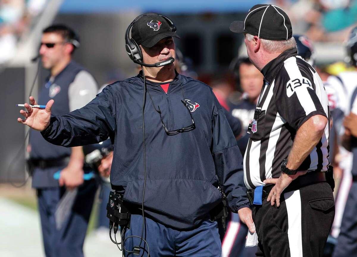 Houston Texans head coach Bill O'Brien talks to head linesman Ed Camp (134) during the second quarter of an NFL football game against the Jacksonville Jaguars at EverBank Field on Sunday, Dec. 17, 2017, in Jacksonville.