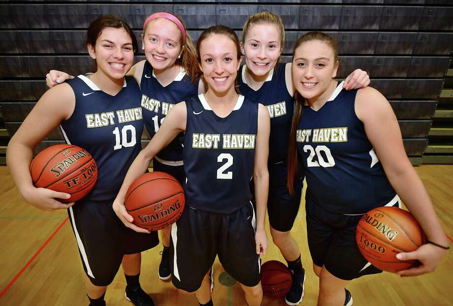 From left, East Haven captains, Olivia Coyle, Marley Herard , Haley Montesanto, Kylie Schlottman and Jessica Stettinger. Photo: Catherine Avalone / Hearst Connecticut Media / New Haven RegisterThe Middletown Press