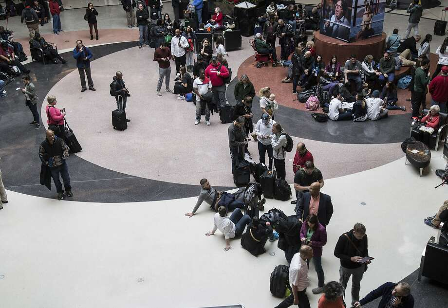 Long lines form at Atlanta's Hartfield-Jackson airport after a power failure. Hundreds of flights were canceled on the eve of the busy holiday rush. Photo: Steve Schaefer, Associated Press