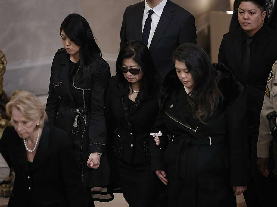 Anita Lee, center, accompanied by her daughters Tania, right, and Brianna, left, arrive for a memorial service for the late San Francisco Mayor Edwin Lee at city hall in San Francisco, Calif., on Sunday, December 17, 2017. Photo: Carlos Avila Gonzalez, The Chronicle
