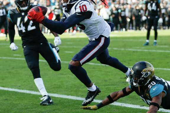 Houston Texans wide receiver DeAndre Hopkins (10) reaches up over Jacksonville Jaguars cornerback Jalen Ramsey (20) for a 25-yard touchdown reception during the third quarter of an NFL football game at EverBank Field on Sunday, Dec. 17, 2017, in Jacksonville.