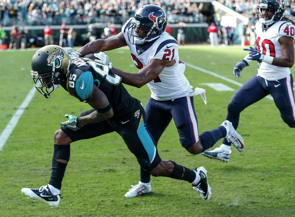 Jacksonville Jaguars wide receiver Jaydon Mickens (85) is knocked out of bounds by Houston Texans strong safety Marcus Gilchrist (21) after making a first down reception during the second quarter of an NFL football game at EverBank Field on Sunday, Dec. 17, 2017, in Jacksonville.