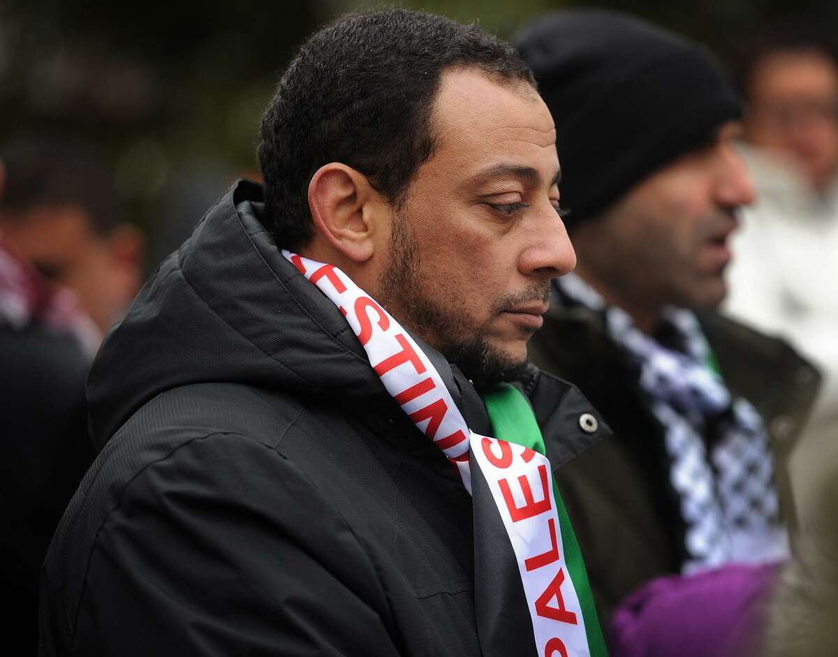 Mostafa Hassan, of Fairfield, attends a rally against the declaration declaring Jerusalem the capital of Israel on McLevy Green in Bridgeport, Conn. on Sunday, December 17, 2017.