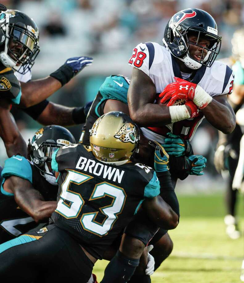 Houston Texans running back Alfred Blue (28) is held up by Jacksonville Jaguars linebacker Blair Brown (53) for a short gain during the fourth quarter of an NFL football game at EverBank Field on Sunday, Dec. 17, 2017, in Jacksonville. Photo: Brett Coomer, Houston Chronicle / © 2017 Houston Chronicle