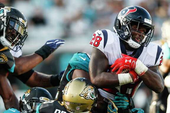 Houston Texans running back Alfred Blue (28) is held up by Jacksonville Jaguars linebacker Blair Brown (53) for a short gain during the fourth quarter of an NFL football game at EverBank Field on Sunday, Dec. 17, 2017, in Jacksonville.
