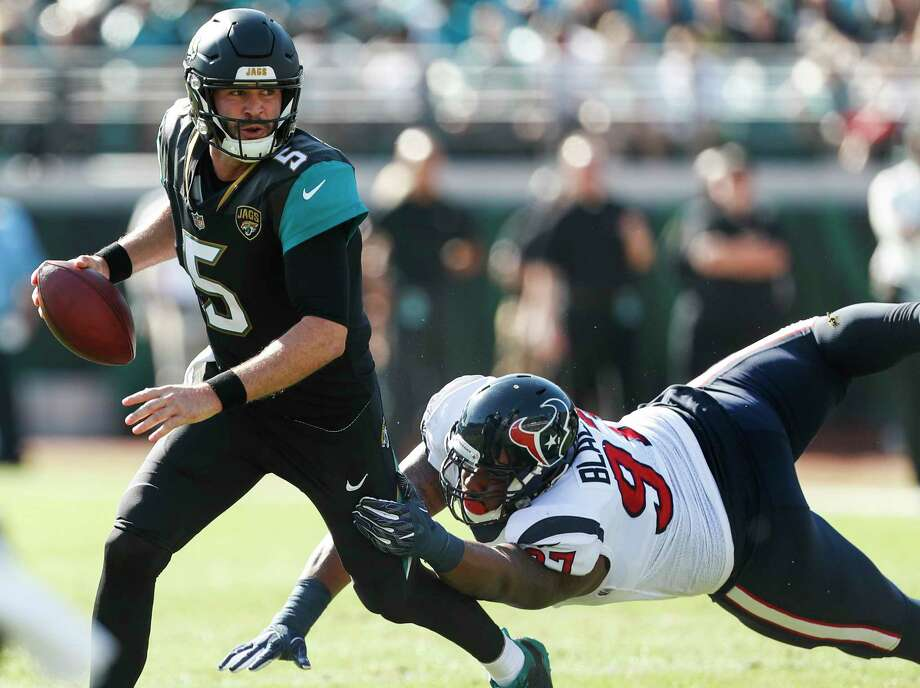 Jacksonville Jaguars quarterback Blake Bortles (5) runs out of the pocket away from Houston Texans defensive tackle Angelo Blackson (97) during the first quarter of an NFL football game at EverBank Field on Sunday, Dec. 17, 2017, in Jacksonville. Photo: Brett Coomer, Houston Chronicle / © 2017 Houston Chronicle