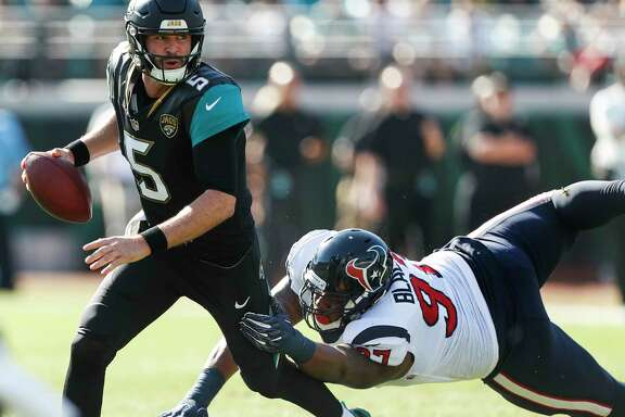 Jacksonville Jaguars quarterback Blake Bortles (5) runs out of the pocket away from Houston Texans defensive tackle Angelo Blackson (97) during the first quarter of an NFL football game at EverBank Field on Sunday, Dec. 17, 2017, in Jacksonville.