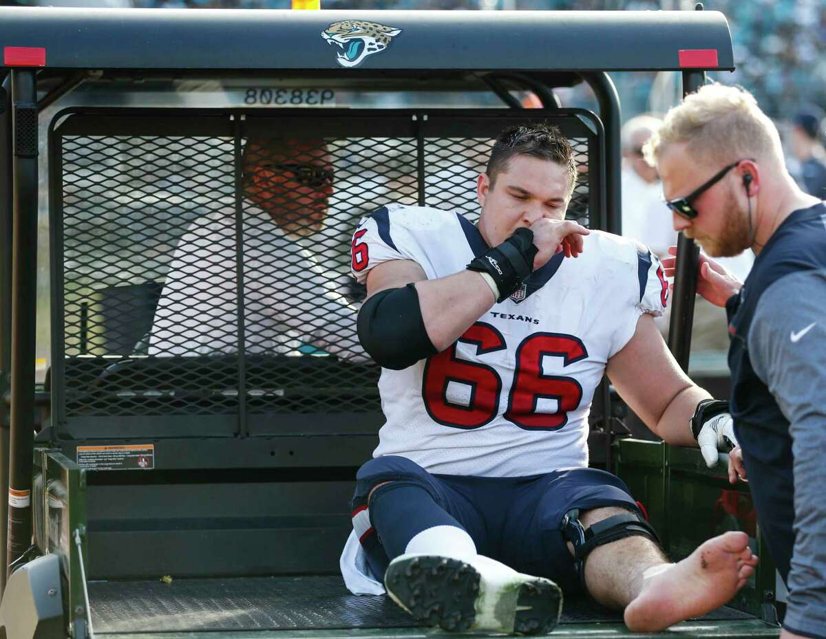Houston Texans center Nick Martin (66) gets onto a cart after injuring his ankle during the third quarter of an NFL football game againt the Jacksonville Jaguars at EverBank Field on Sunday, Dec. 17, 2017, in Jacksonville.