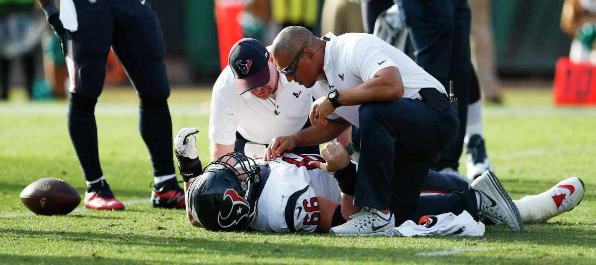 Houston Texans center Nick Martin (66) is tended to by the Texans medical staff after injuring his ankle during the third quarter of an NFL football game againt the Jacksonville Jaguars at EverBank Field on Sunday, Dec. 17, 2017, in Jacksonville.