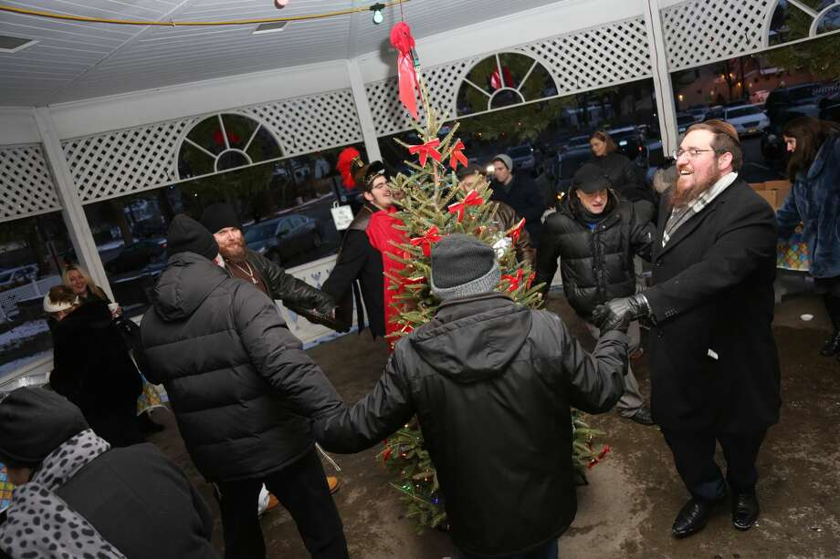 """The Fairfield Menorah Lighting took place on the Town Green December 17, 2017. Families enjoyed latkes and donuts, music from Judah the Macabee and activities for the kids. The Fairfield Fire Department treated the crowd to chocolate gelt """"raining"""" down from a rescue truck. Were you SEEN? Photo: Derek Sterling/Hearst CT Media"""