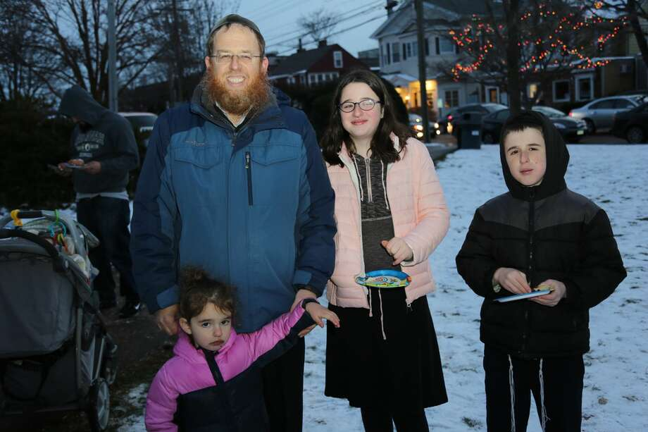 "The Fairfield Menorah Lighting took place on the Town Green December 17, 2017. Families enjoyed latkes and donuts, music from Judah the Macabee and activities for the kids. The Fairfield Fire Department treated the crowd to chocolate gelt ""raining"" down from a rescue truck. Were you SEEN? Photo: Derek Sterling/Hearst CT Media"