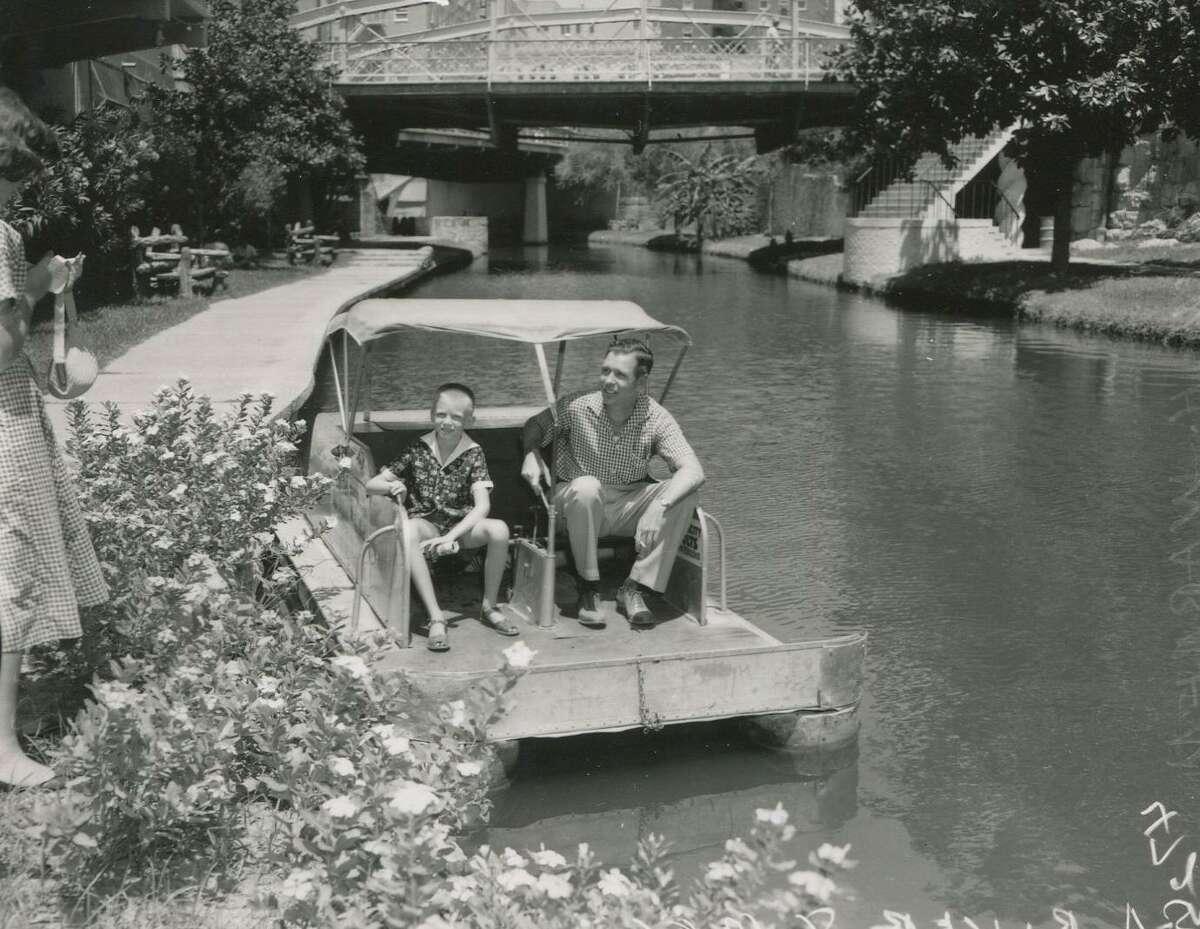 John H. Warren and son Bill in a paddle boat on the San Antonio River, circa 1956.
