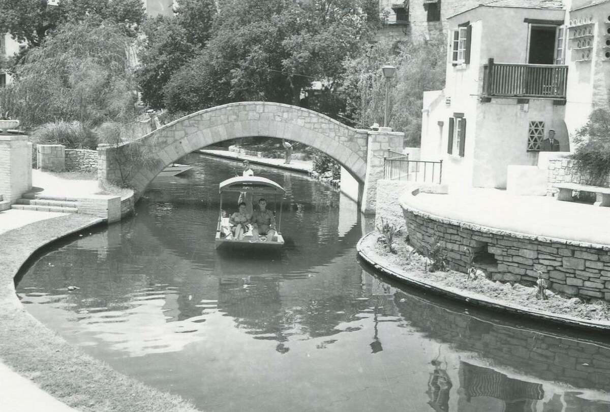Sgt. John Donovan and Jean Anderson get a view of downtown San Antonio as they are poled down the river by Jimmie Huebner in this photo published July 26, 1942. The flat bottomed boats are similar to a type seen in Mexico.