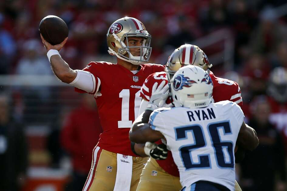 San Francisco 49ers quarterback Jimmy Garoppolo, left, throws against the Tennessee Titans during the first half of an NFL football game Sunday, Dec. 17, 2017, in Santa Clara, Calif. (AP Photo/D. Ross Cameron)