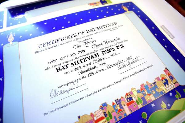 Certificates were given to residents at a b'nai mitzvah Hanukkah service.