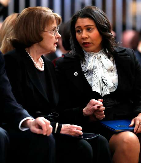 Sen. Dianne Feinstein (left) and San Francisco then-acting Mayor London Breed hold hands before a service celebrating the life of Mayor Ed Lee at San Francisco City Hall in December. Photo: Scott Strazzante, The Chronicle