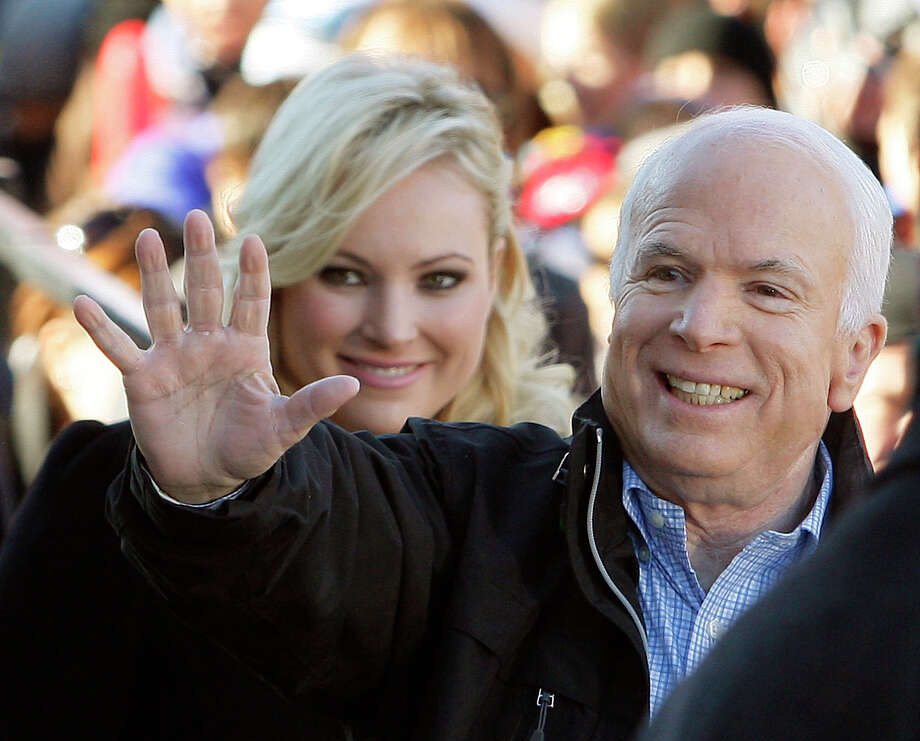 "FILE - In this Oct. 30, 20087 file photo, Republican presidential candidate Sen. John McCain, R-Ariz., accompanied by his daughter Meghan McCain, waves to supporters as he enters a campaign rally in Defiance, Ohio.  Former Vice President Joe Biden sought to console the daughter of ailing Sen. John McCain after she began crying while discussing her father's cancer on ABC's ""The View."" McCain is battling the same aggressive type of brain cancer that killed Biden's son Beau in 2015.  (AP Photo/Stephan Savoia) Photo: Stephan Savoia, STF / AP2008"