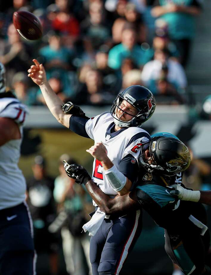 Houston Texans quarterback T.J. Yates (2) loses the handle on the football as he is hit by Jacksonville Jaguars defensive end Yannick Ngakoue (91) for an incomplete pass during the third quarter of an NFL football game at EverBank Field on Sunday, Dec. 17, 2017, in Jacksonville. ( Brett Coomer / Houston Chronicle ) Photo: Brett Coomer, Staff / © 2017 Houston Chronicle
