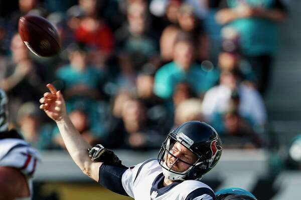 Houston Texans quarterback T.J. Yates (2) loses the handle on the football as he is hit by Jacksonville Jaguars defensive end Yannick Ngakoue (91) for an incomplete pass during the third quarter of an NFL football game at EverBank Field on Sunday, Dec. 17, 2017, in Jacksonville. ( Brett Coomer / Houston Chronicle )