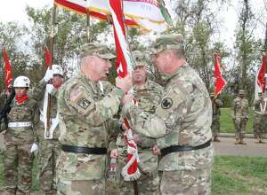 Army Reserve Maj. Gen. Daniel Christian, left, receives 412th Theater Engineer Command flag from Maj. Gen. Scotie carpenter, Army Reserve Command deputy commander, during a change of command ceremony at Vicksburg National Military Park, Vicksburg, Miss. (Lt. Col. Kavanaugh / Army Reserve)
