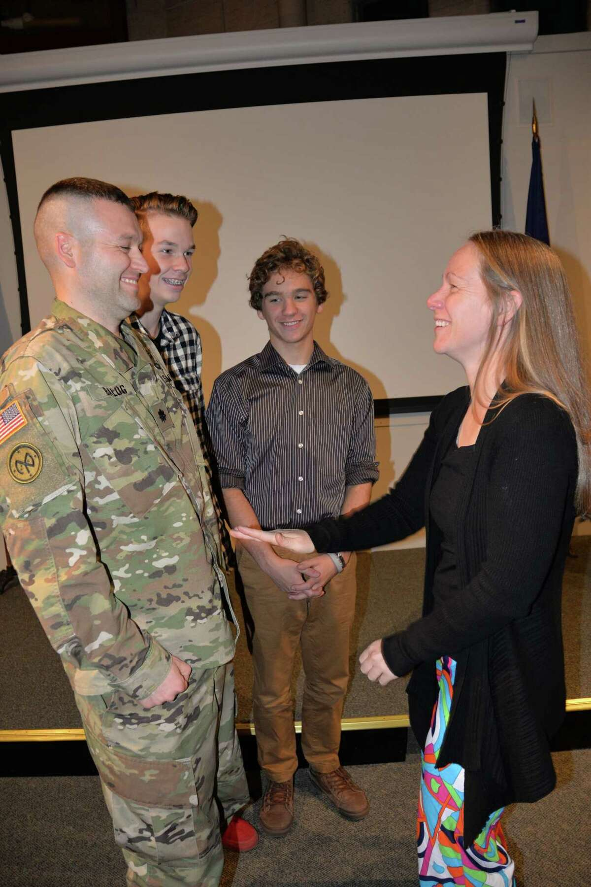 Army National Guard Lt. Col. Todd Balog, Special Troops Battalion commander, is congratulated by his wife Amy and sons Hyrum and Aiden following his promotion by Col. Stephen M. Bousquet, 369th Sustainment Brigade commander, at the New York State Military Museum in Saratoga Springs. (New York Army National Guard)