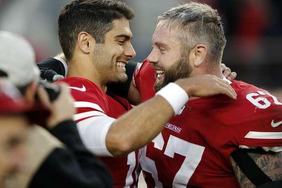 San Francisco 49ers quarterback Jimmy Garoppolo, left, hugs teammate Daniel Kilgore after a 25-23 win over the Tennessee Titans during an NFL football game Sunday, Dec. 17, 2017, in Santa Clara, Calif. (AP Photo/John Hefti)